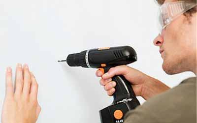 Drill plaster wall